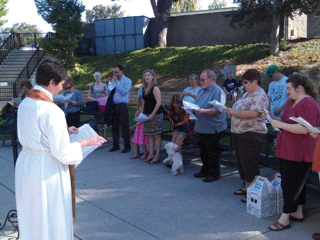 Rev. Kelly O'Connell speaking to congregation during a blessing of the animals.