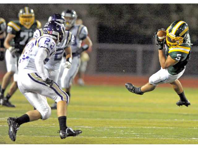 Canyon running back Daniel Castro (5) makes a catch during a game against Valencia on Friday at Canyon High.