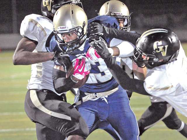 West Ranch running back Mark Collins (23) weaves through Golden Valley defenders Friday night at Valencia High School.