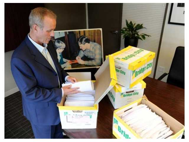 Portland attorney Kelly Clark examines some of the 14,500 pages of previously confidential documents created by the Boy Scouts of America concerning child sexual abuse within the organization. The Boy Scouts of America fought to keep those files confidential.