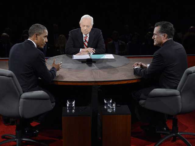 President Barack Obama speaks as Republican presidential nominee Mitt Romney and moderator Bob Schieffer listen.