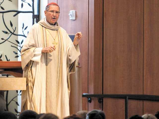 Cardinal Roger Mahony, retired, leads the celebration of Saint Kateri's canonization mass at St. Kateri Tekakwitha Catholic Church in Santa Clarita on Sunday.