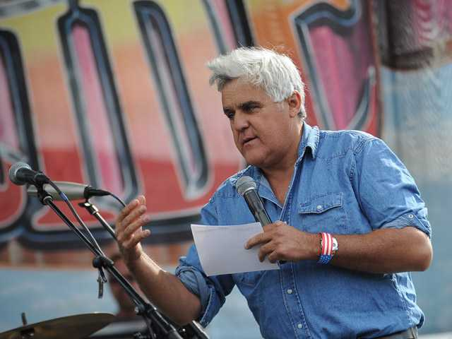 Jay Leno, grand marshal of the 29th annual Love Ride speaks to the crowd after he arrived at Castaic Lake on his Harley Davidson motorcycle. (Jayne Kamin-Oncea/For The Signal)