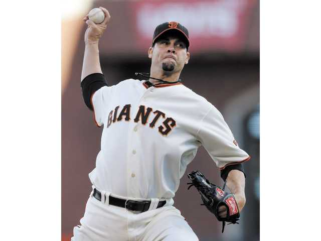 San Francisco Giants starting pitcher Ryan Vogelsong throws against the St. Louis Cardinals on Sunday in San Francisco.