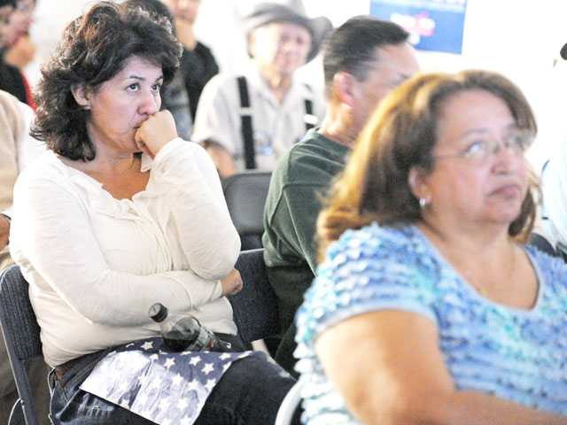 Leticia Aranda, of Valencia, watches the presidential debate at the Democratic Alliance for Action headquarters in Newhall on Monday.