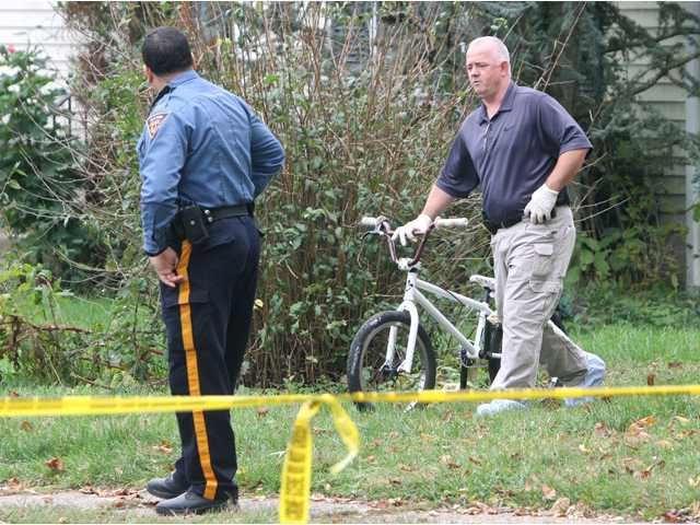 Police remove a bicycle from a home near where a 12-year-old Autumn Pasquale's body was found in a recycling bin.