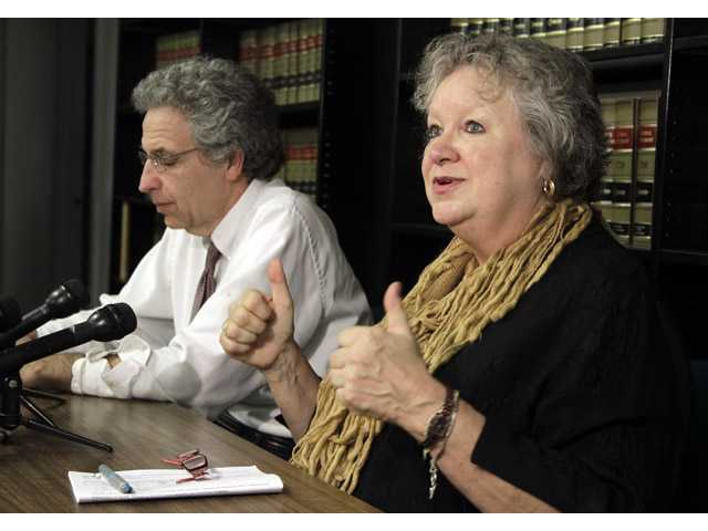 Ken Falk, left, legal director for the ACLU of Indiana, listens as Betty Cockrum, president of Planned Parenthood of Indiana, discusses a ruling.