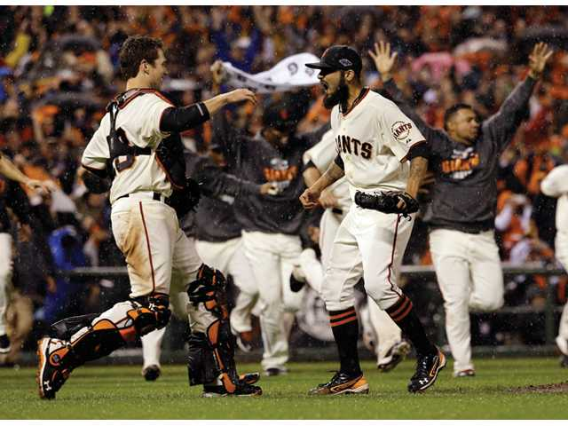 San Francisco Giants relief pitcher Sergio Romo and catcher Buster Posey react after the final out in Game 7 of baseball's National League Championship Series against the St. Louis Cardinals on Monday in San Francisco.