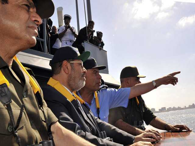 Egyptian President Mohammed Morsi, second left, observes a military drill dubbed Naval Victory 45.
