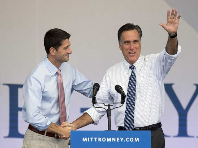 Republican presidential candidate former Massachusetts Gov. Mitt Romney, right, is greeted by running mate Rep. Paul Ryan.