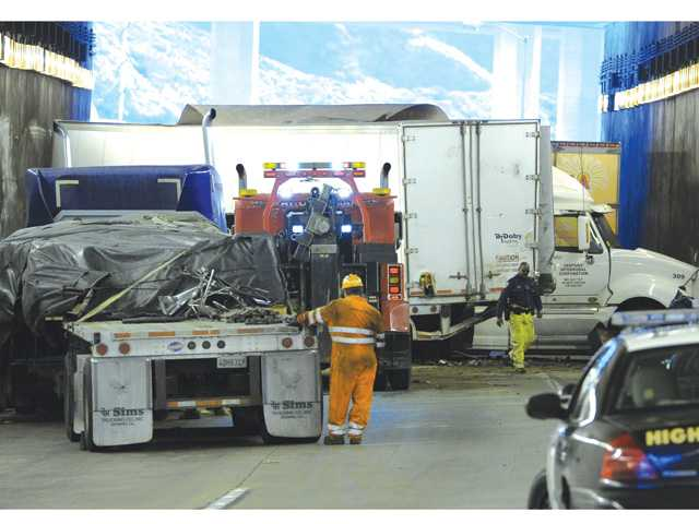 The scene inside the tunnel of a crash involving multiple big-rig trucks at the southbound Interstate 5 truck tunnel in the Newhall Pass that occurred in the early morning hours on Tuesday.