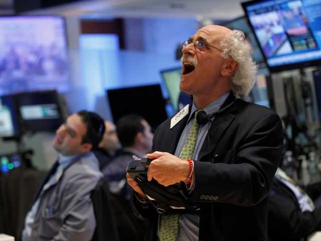 Trader Peter Tuchman reacts as he looks at the numbers during the closing bell on the floor of the New York Stock Exchange.