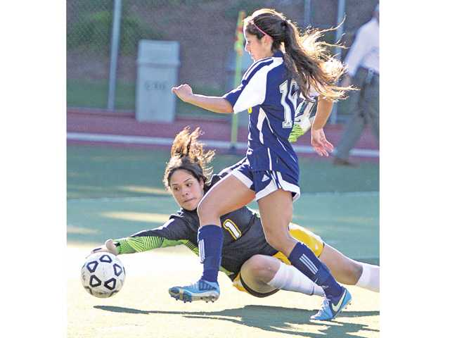 College of the Canyons' Brianna Helton, right, scores a goal on Tuesday at COC.