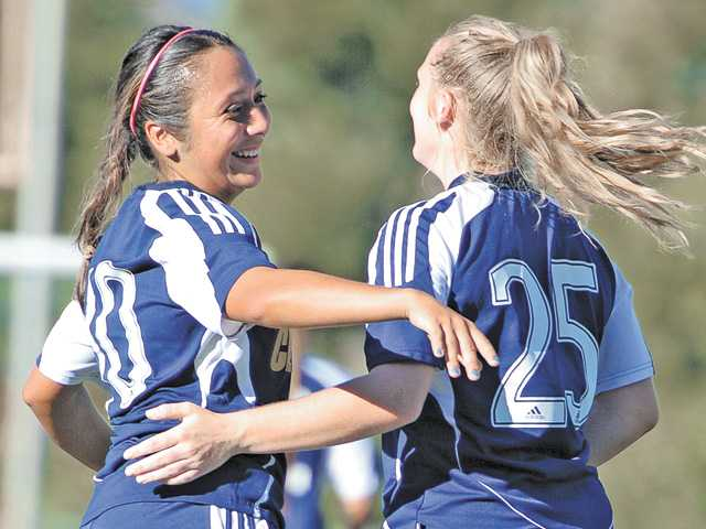 College of the Canyons sophomore Kaeli Rohland, right, congratulates Sabrina Serafin after Serafin scored a goal against Los Angeles Valley College on Tuesday at COC.