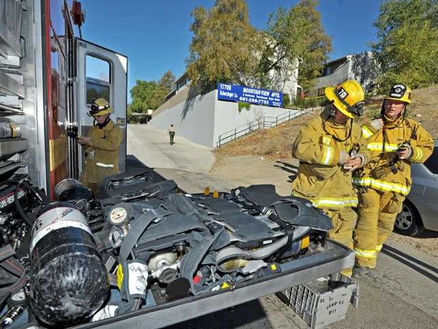 A fire department Hazardous Materials Squad responds to the scene of an explosion on the 17700 block of Scherzinger Lane in Canyon Country on Wednesday.