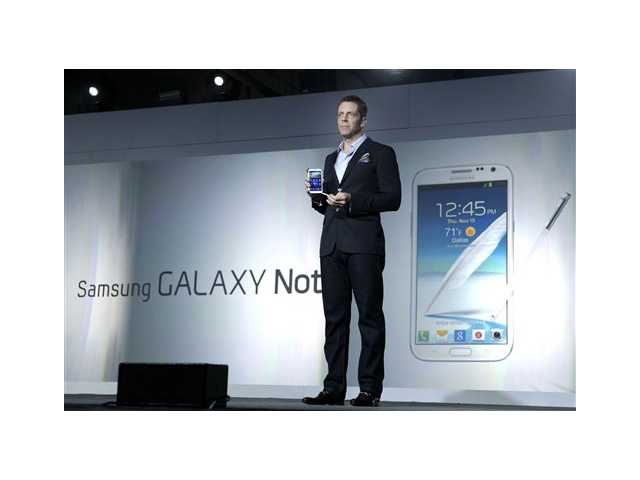 Kevin Packingham, chief product officer for Samsung Mobile USA, demonstrates the new Samsung Galaxy Note II during a launch event, on Wednesday, in New York.
