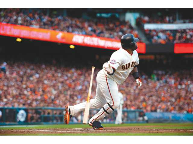 San Francisco Giant Pablo Sandoval (48) watches his solo home run against the Detroit Tigers ion Wednesday in San Francisco.