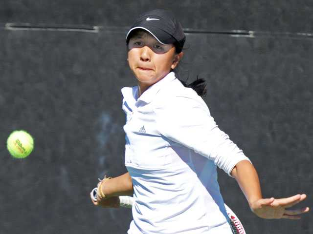 Hart singles player Proyfon Lohaphaisan gets ready to return the ball during the Foothill League Individual Tournament on Wednesday at The Paseo Club.