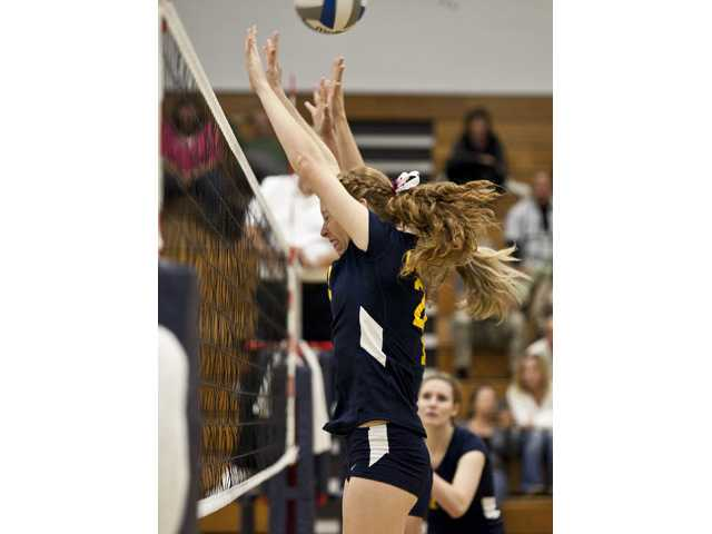 College of the Canyons sophomore Kelsea Hundtoft goes up for a block on Wednesday night at COC.