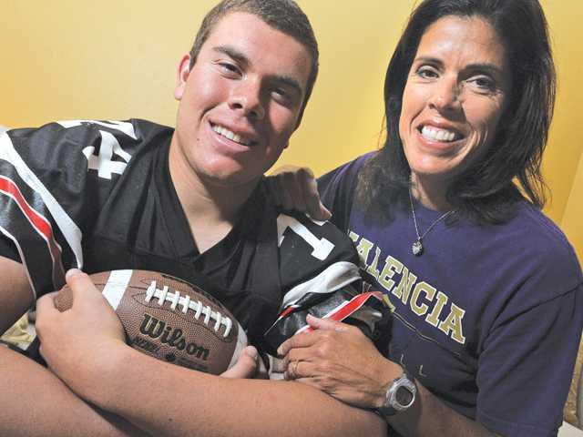 Austin Lee's Hart football team plays Valencia tonight. His mom Donna is the Vikings head softball coach.
