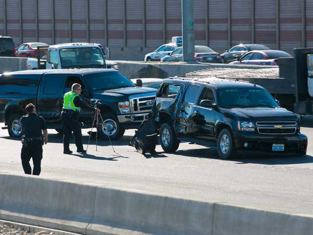 Police investigate the scene of a six-vehicle accident involving U.S. Sen. Harry Reid's motorcade on Interstate 15 in Las Vegas on Friday.