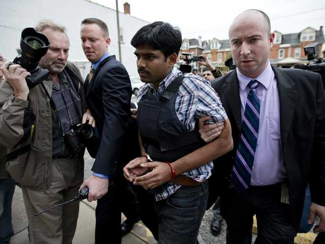 Raghunandan Yandamuri is escorted to a Montgomery County district court for an arraignment Fridayin Bridgeport, Pa.