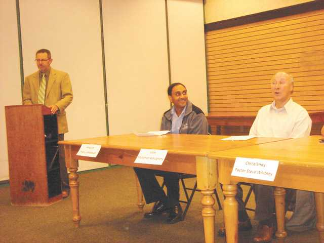 Jonathan Kraut, president of Santa Clarita Valley Interfaith Council and moderator at the council meeting, left, and panelists Prabhu Ambatipudi, Hinduism representative, center, and Mohamed Abdulghany, Islam representative.