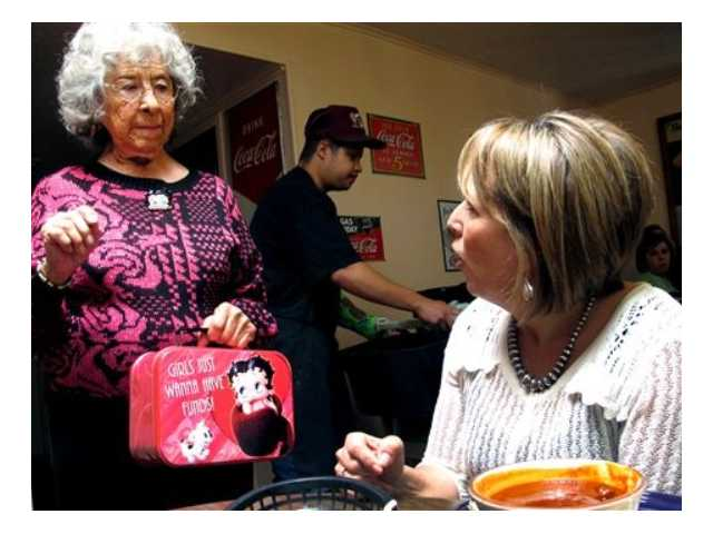 New Mexico Democratic Congressional candidate Michelle Lujan Grisham, right, talks with Betty Minero, 88, at Barelas Coffee House in Albuquerque, N.M. on Oct. 19. A total of 49 Latino candidates - 32 Democrats, 16 Republicans and one without a declared party - are seeking House seats this year, according to the bipartisan National Association of Latino Elected and Appointed Officials. Depending on how many of them win, their numbers in the House could make history.