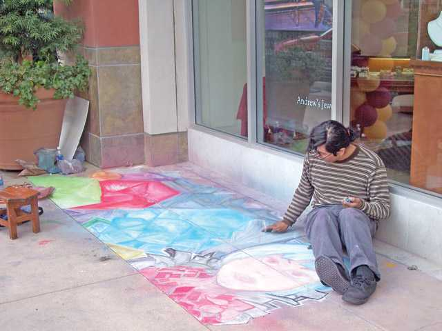 A chalk artist brightens up Town Center Drive.