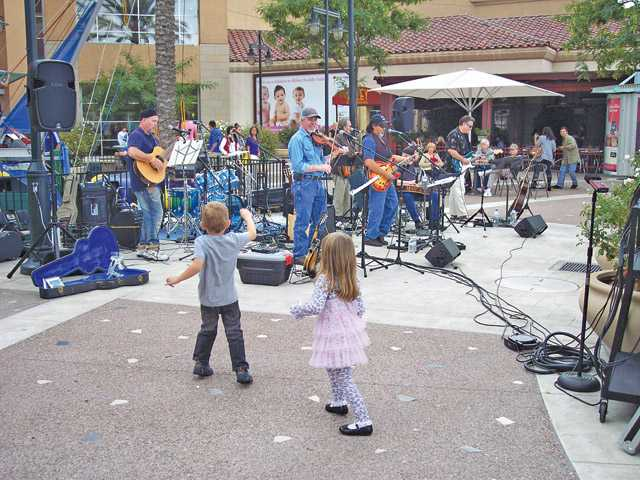 Children dance to Fahr.West at the fifth annual Wine Affair held on Town Center Drive in Valencia.