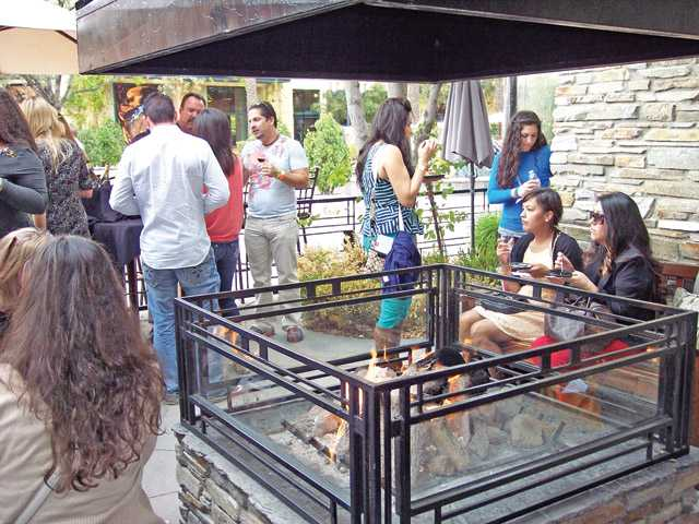 Wine Affair guests enjoy the fire pit at Salt Creek Grille.