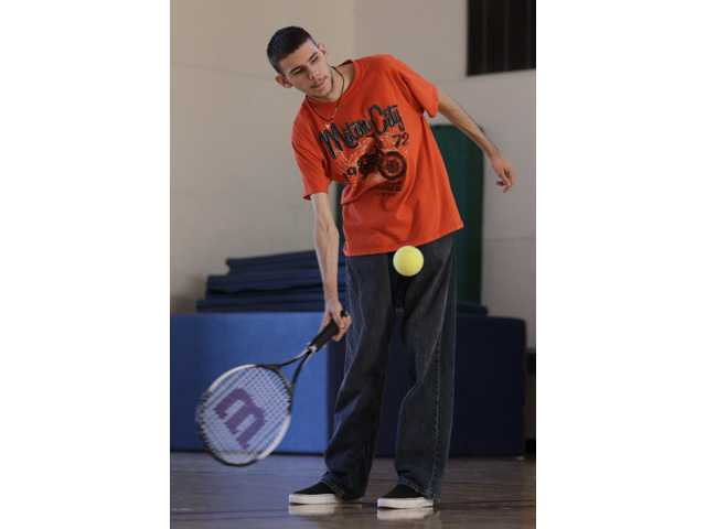 Austin Benavidez, who is blind, returns a volley using an oversized ball filled with ball bearings at the California School for the Blind in Fremont.