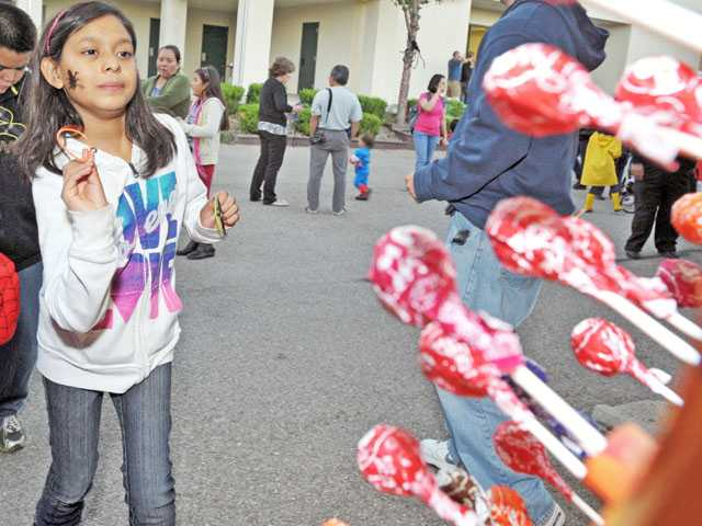 "Fifth-grader Amanda Quintana, 10, plays the ""Leaf Toss."""