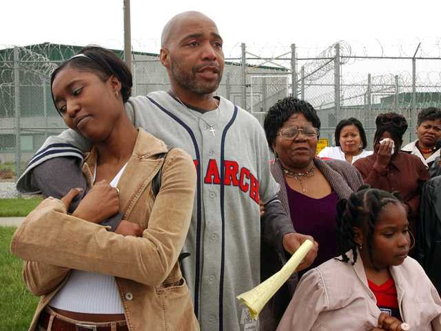 In 2003 photo, Terry Harrington, center, stands with his family and friends outside the Clarinda Correctional Facility in Clarinda, Iowa, after Gov. Tom Vilsack signed his reprieve.