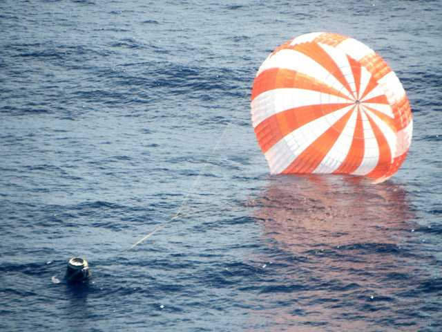 This photo provided by SpaceX shows an unmanned Dragon freighter during its splashdown Sunday.
