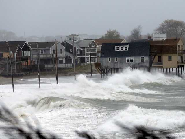 Ocean waves kick up near homes along Peggoty Beach in Scituate, Mass. Monday, Oct. 29, 2012.