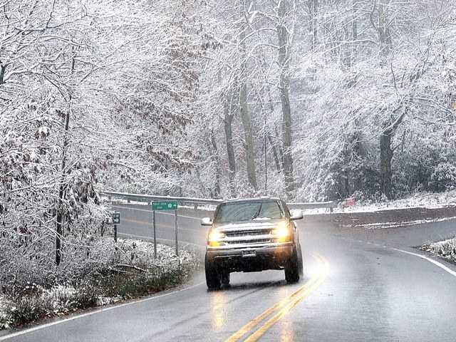 Snow sticking to tree limbs on Grandview Road in Beckley, W.Va. Mondayas Hurricane Sandy wheeled toward land as forecasters feared.