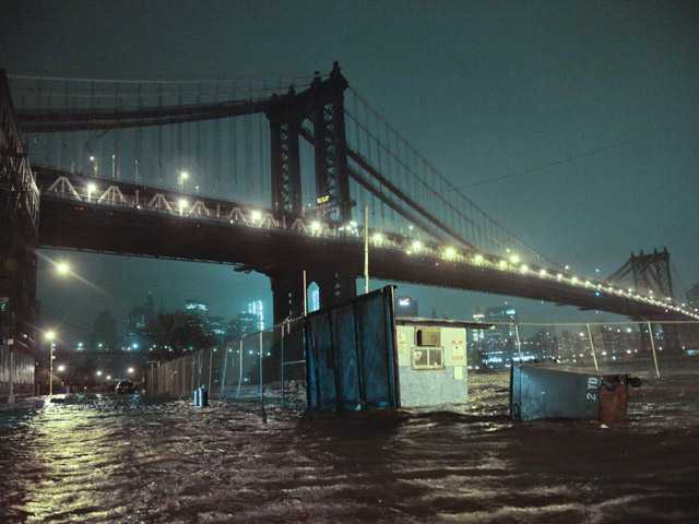 Streets are flooded under the Manhattan Bridge in the Dumbo section of Brooklyn, N.Y., Monday.