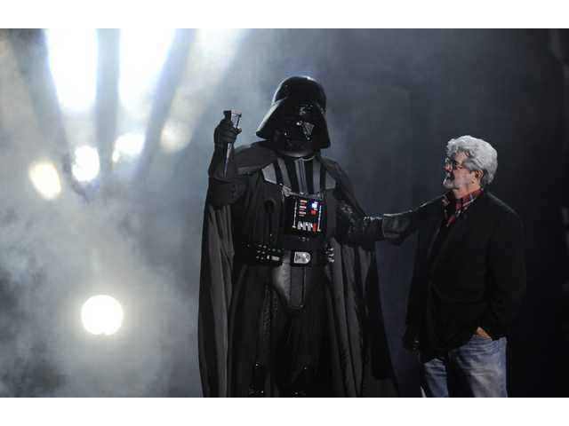 """Darth Vader"" accepts the Ultimate Villain award from ""Star Wars"" creator George Lucas during the 2011 Scream Awards."