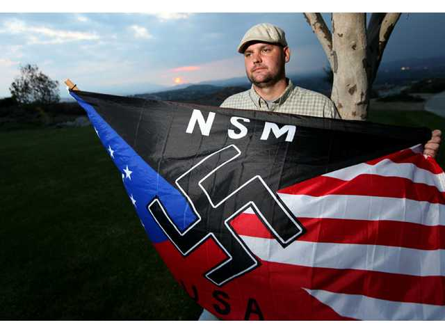 Jeff Hall holds a Neo Nazi flag, the trial begins for his 10-year-old son, who shot Hall dead as he slept on the couch in 2010.