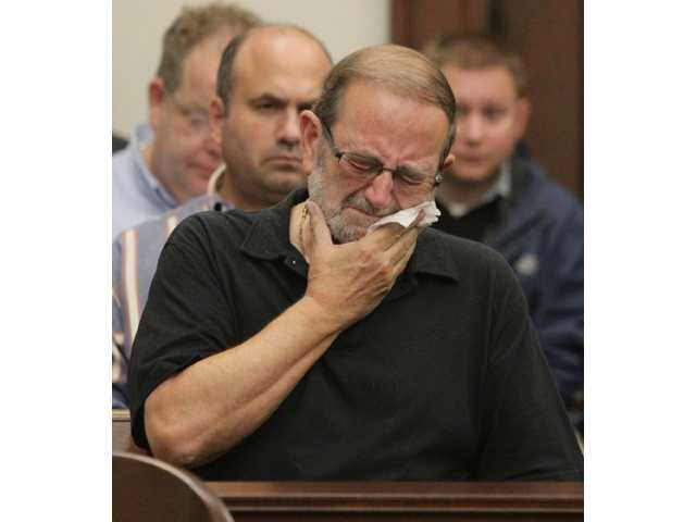 Jack Kern reacts after a jury reached a guilty verdict on all accounts in the Brogan Rafferty Craigslist murder trial.