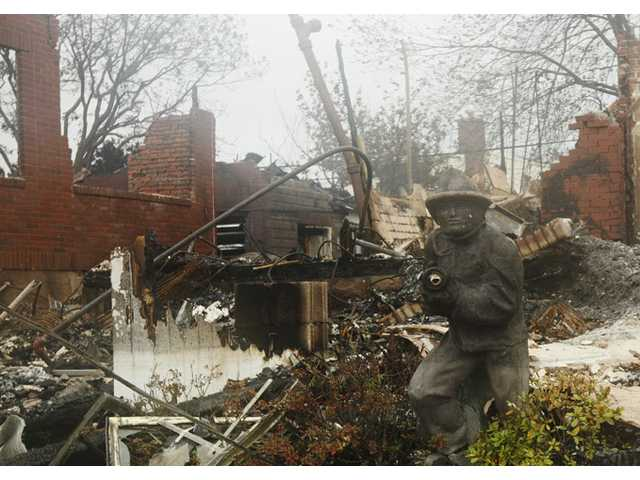 A home damaged by fire is shown in the Belle Harbor neighborhood in the New York City borough of Queens Tuesday.