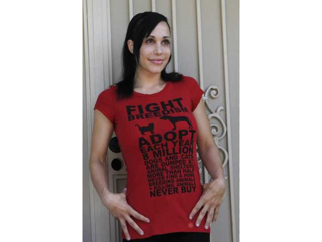 """Octomom"" Nadya Suleman wears a t-shirt promoting pet birth control outside her home in La Habra, Calif."