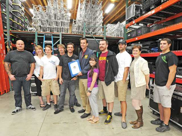 Assemblyman Cameron Smyth, center, recognizes Derek Sage and his team at SOS Entertainment as the Small Business of the Year from the 38th District.