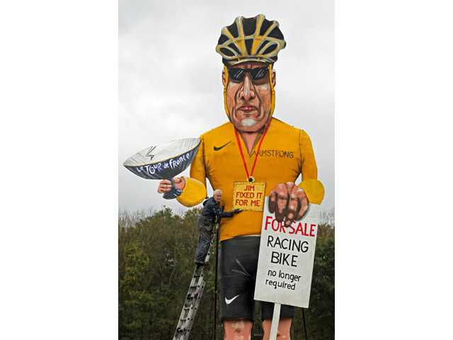 Artist Frank Shepherd poses with his creation of U.S. cyclist Lance Armstrong, unveiled as this year's Edenbridge Bonfire Society celebrity.