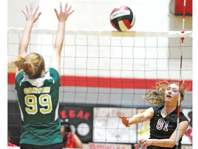 Hart outside hitter Amy King (81) hits past Canyon defender Robyn Underwood on Tuesday at Hart High School. The Indians won 3-0.