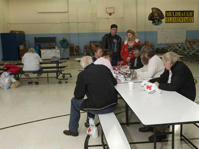 Residents of West Point, Ky., living within a mile-and-a-half radius of the site of a train derailment, wait at a Red Cross shelter.
