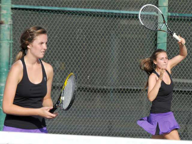 Valencia doubles teammates Ashley Keith, left, and Tina Inchalik compete against La Canada in a CIF-Southern Section Division II playoff match on Wednesday at Valencia.