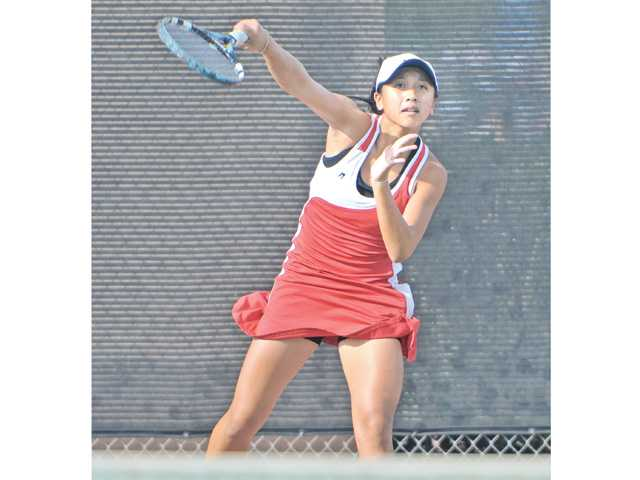 Hart's Proyfon Lohaphaisan serves against Chadwick at Hart High on Wednesday. Lohaphaisan won two sets 6-1, 6-0.