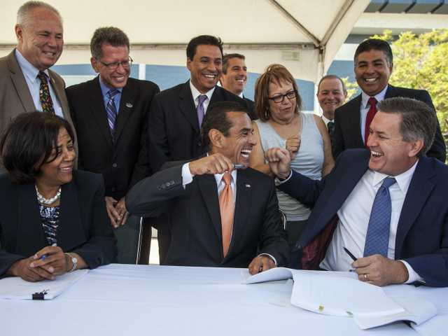 "Councilwoman Jan Perry, Los Angeles Mayor Antonio Villaraigosa, and Anschutz Entertainment Group (AEG) President Tim Leiweke joke before signing an ""implementation agreement"" for the modernization of the Los Angeles Convention Center and the construction of a new NFL stadium in downtown Los Angeles on Oct. 3."